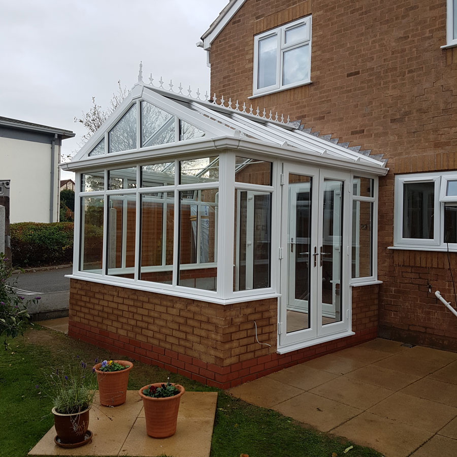 Window door and roof ideas for your new conservatory for Windows doors and conservatories