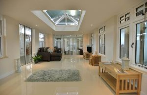 Modern with orangery with shiny floor and oak furniture