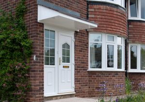 uPVC entrance door with covering